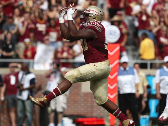 FSU's Demarcus Christmas celebrates a sack against