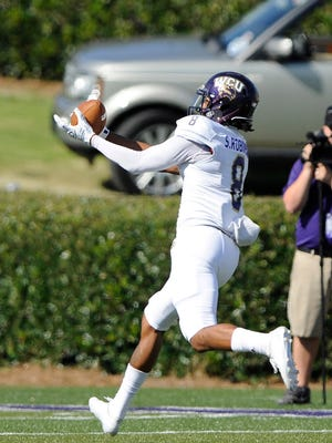 Western Carolina's Spearman Robinson (8) makes one of his touchdown catches against Furman.