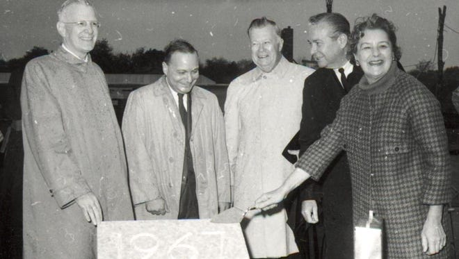 Then Ohio Gov. Jim Rhodes (second from right) was among dignitaries displaying the cornerstone of the first UC Blue Ash College building in 1967.