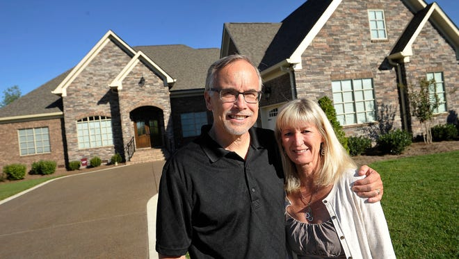 Robin and Chuck Adelman at their home in Foxland Harbor near Gallatin. The couple moved here from Chicago.
