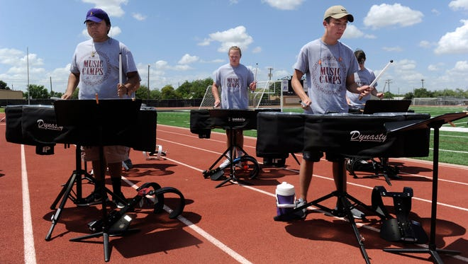 Drummers perform Wednesday July 19, 2017 at Wilford Moore Stadium on the McMurry University campus during an exhibition of the McMurry Marching Arts Camp.