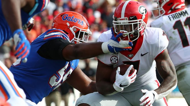 The Gators will look to defensive lineman Kyree Campbell, left, to help stuff Georgia's running game.
