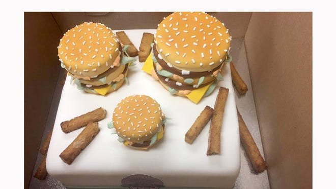 The crew at Fairview McDonalds received a custom-made Grand Mac cake for winning the video jingle contest.