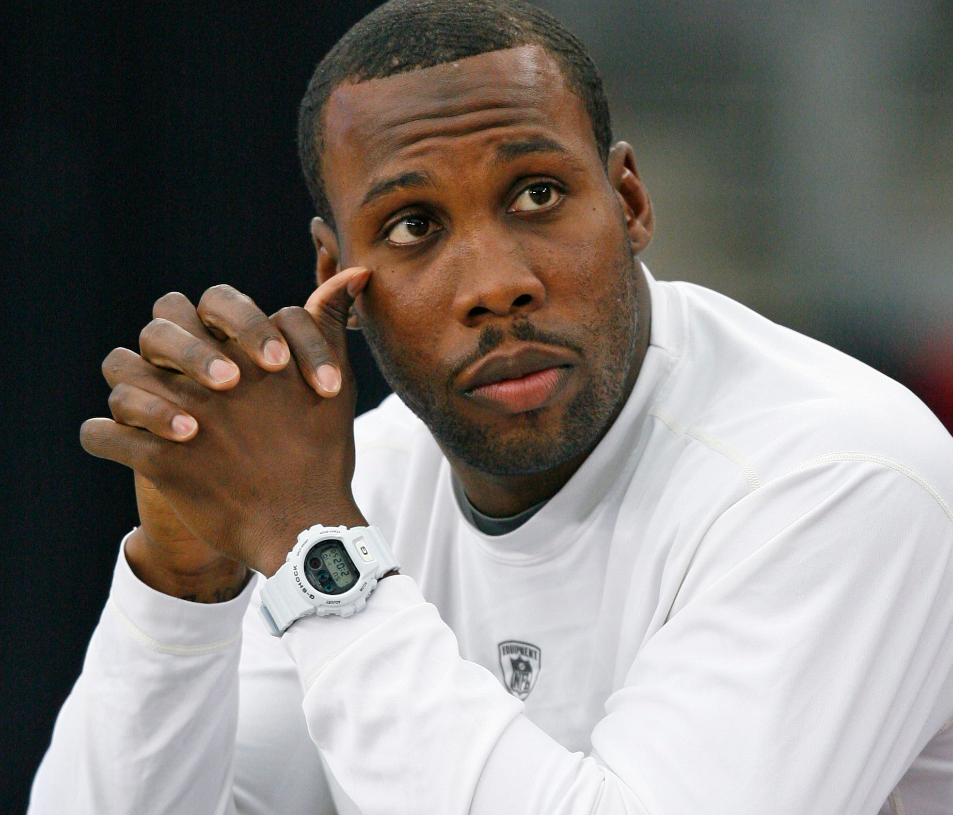 Anquan Boldin, who played for several teams including the Arizona Boldin sits on the bench as his team prepares for the NFL NFC wild-card playoff football game.