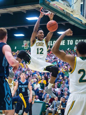 The University of Vermont's Darren Payen dunks against the University of Maine on Wednesday, March 1, 2017.