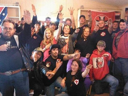 Members of the Missouri chapter of the Confederate White Knights pose for a picture and give a common KKK salute. This photo was obtained and identified by the Anti-Defamation League as part of their efforts to track the KKK across the country.