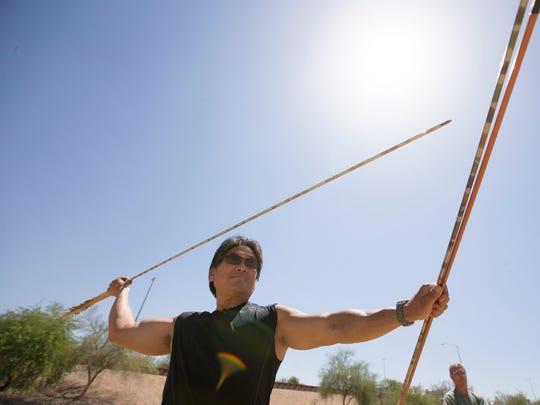 Charlie Tadano throws an atlatl dart with an atlatl. Archeologists have found mammoth kill sites near Sierra Vista containing atlatl dart points.  Pat Shannahan/The Arizona Republic