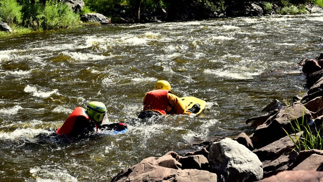 Larimer County Dive Rescue Team members at a swift water rescue training in June 2017.