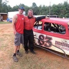 "Nathaniel ""Thumper"" Grice poses with his father Roger ""Scooter"" Grice in advance of Friday night's Vintage Racing Association 20-lap feature at Five Flags Speedway."