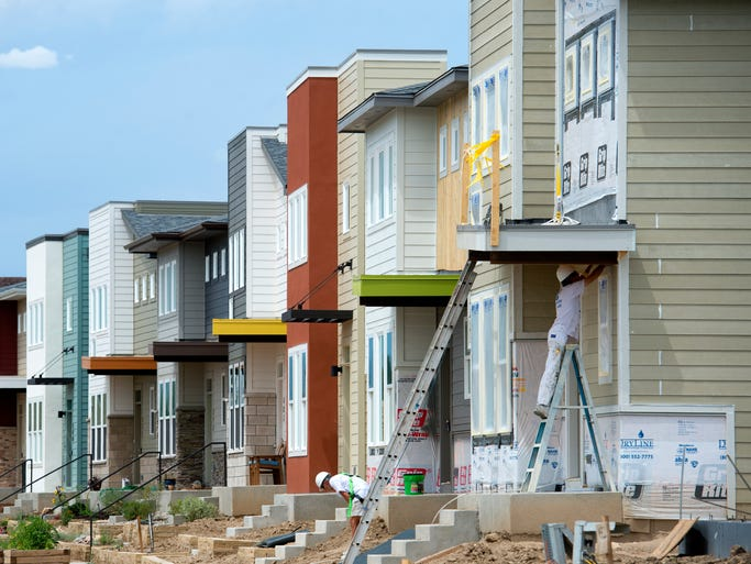 Some houses are being finished, right, next to completed homes in the Old Town North neighborhood Monday, August 4, 2014. About 40 homes are either under construction, recently finished or have building permits pending.