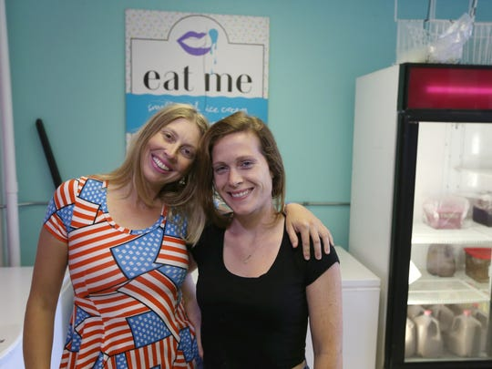 The women behind Eat Me Ice Cream, co-owners Catelyn Augustine, left, and Amber Odhner, right, in their ice cream shop in Rochester.