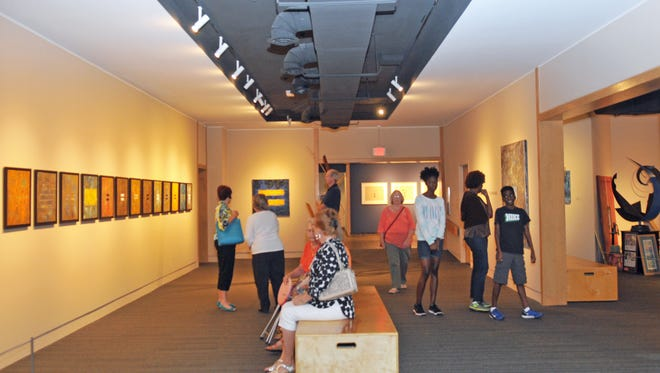 Guests enjoy an exhibit at the Foosaner Art Museum.