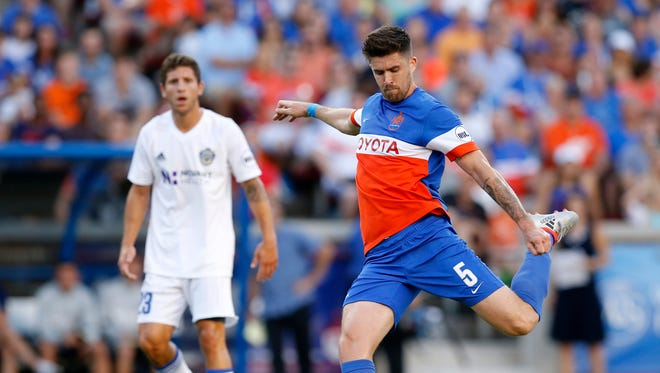 FC Cincinnati's Aodhan Quinn (5) shoots in the first half of the USL Soccer match between FC Cincinnati and Charlotte Independence at Nippert Stadium on June 10, 2017