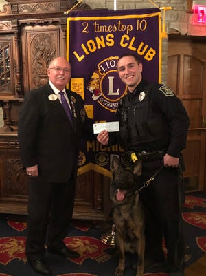Chesterfield Township police dog Viper and Officer John Amore received a donation to buy body armor for Viper.