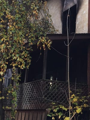 Front of the house damaged by fire and the burned out second-floor window on Wesley Chapel Road in Wesley Hills during early morning fire Wednesday, Nov. 16, 2017