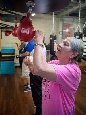 Dee Carter works a speed bag during a demonstration for Rock Steady Boxing, a fitness program designed to lessen the symptoms of Parkinson's Disease at SNAP Fitness in Cedar City Wednesday, April 4, 2018. Rock Steady, SNAP Fitness, and Southern Utah University's Fitness Alliance partnered together to showcase the programs available for those suffering from the disease.