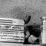 Who Will Find? The Rochester Health Bureau began tossing these two types of note-bearing drift bottles into Lake Ontario, as part of current and pollution study. Finders are asked to mail cards to Health Bureau. (Staff photo, 6/1957) DC 6/13/1957
