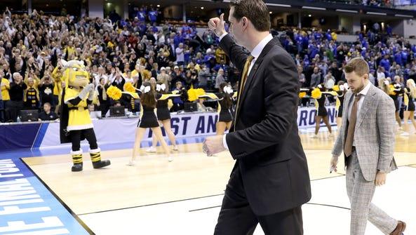 Northern Kentucky head coach John Brannen gives a thumbs