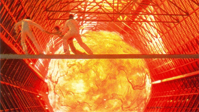"""In 1979's """"The Black Hole,"""" Dan (Robert Forster) and Charlie (Joseph Bottoms) help Kate (Yvette Mimieux) escape from a meteor."""