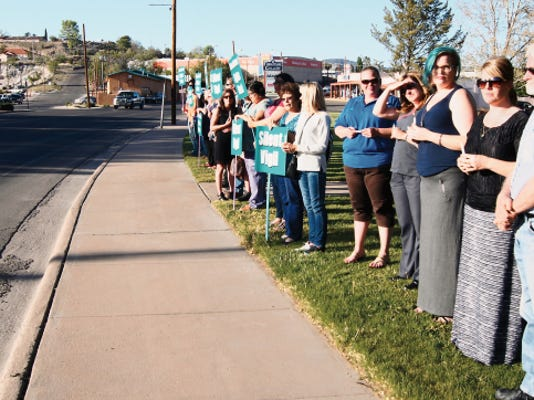 Community members gathered in Gough Park on Wednesday for a silent vigil in observation of National Crime Victims Rights Week. Randal Seyler- Sun-News