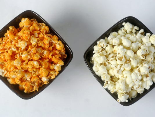 Instead of eating cheddar popcorn, shown on the left, a healthy alternative could be eating air popped pocorn. Both are natural sources of fiber and usually low calorie, but air-popped popcorn has fewer ingredients, doesn't have artificial coloring and wouldn't have trans fat.