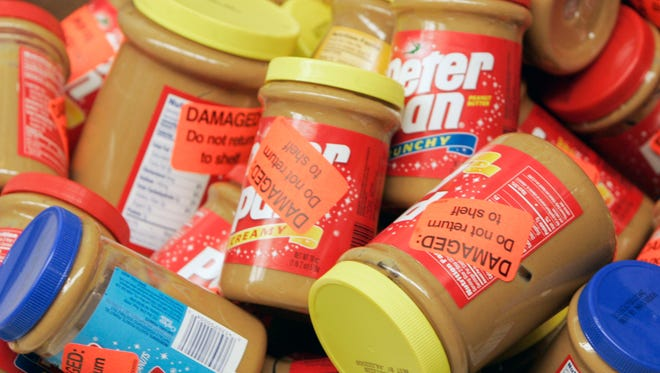 In this Feb. 16, 2007, file photo, returned jars of Peter Pan Peanut Butter are shown at a super market in Atlanta.