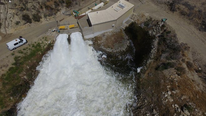 Waters is released from the Santa Felicia Dam at Lake Piru in June 2017. United Water Conservation District oversees the operation of the dam.