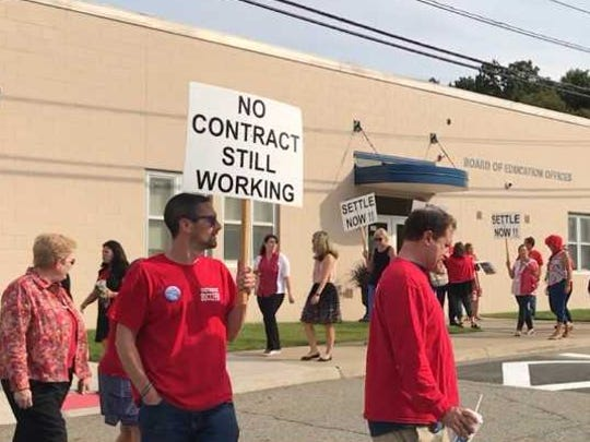 Teachers picket outside the Board of Education office at Indian Hills High School on Sept 12.