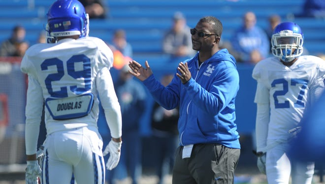 New defensive backs coach Steve Clinkscale works with players during a UK spring football practice at Commonwealth Stadium in Lexington, Ky., on Saturday, March 26th, 2016.  Photo by Mike Weaver