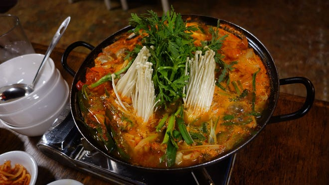 This bubbling cauldron of spicy stew is stuffed with vegetables and lots of intestines from Cafe Ga Hyang in Glendale.