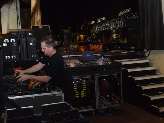Chad Griswold checks sound levels as a crew sets up the stage in the Mari Center at the Paragon Casino in Marksville for the KC & the Sunshine Band concert held last weekend.