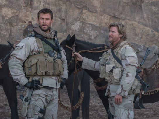 "Chris Hemsworth as Capt. Mitch Nelson and Thad Luckinbill as Vern Michaels in ""12 Strong."""