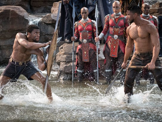 "T'Challa/Black Panther (Chadwick Boseman) and Erik Killmonger (Michael B. Jordan) in ""Black Panther."""