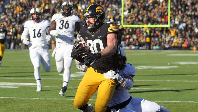 Senior Henry Krieger Coble reaches end zone for first time at Kinnick Stadium in victory over Purdue.