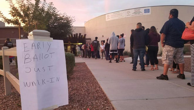 Voters line up at Cheatham School in the Laveen area of Phoenix Tuesday.