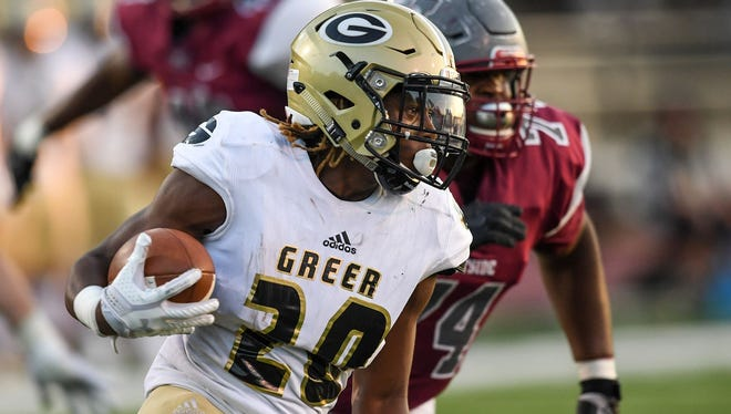 Qua White (20) and the Greer Yellow Jackets are No. 8 in Class AAAA in this week's S.C. Prep Football Media Poll.