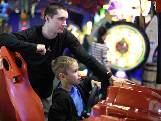 Customers play in the arcade at Incredible Pizza Company