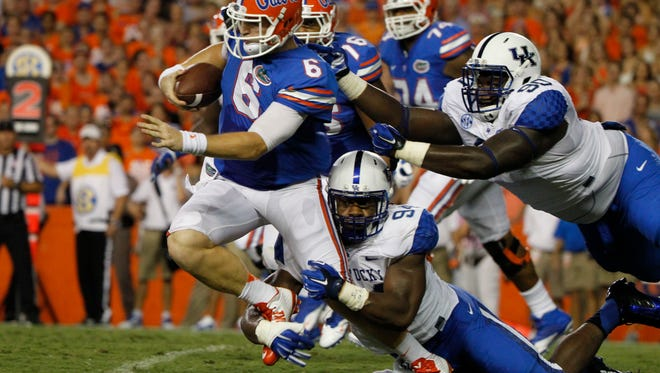 Sep 13, 2014; Gainesville, FL, USA; Kentucky Wildcats defensive end Za'Darius Smith (94) tackles Florida Gators quarterback Jeff Driskel (6) during the first quarter at Ben Hill Griffin Stadium. Mandatory Credit: Kim Klement-USA TODAY Sports