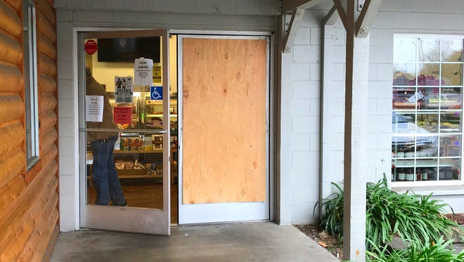 A door to R&R Quality Meats & Seafood in Redding was boarded up Sunday after thieves tried to smash their way in and steal a cash register earlier in the day, police said.