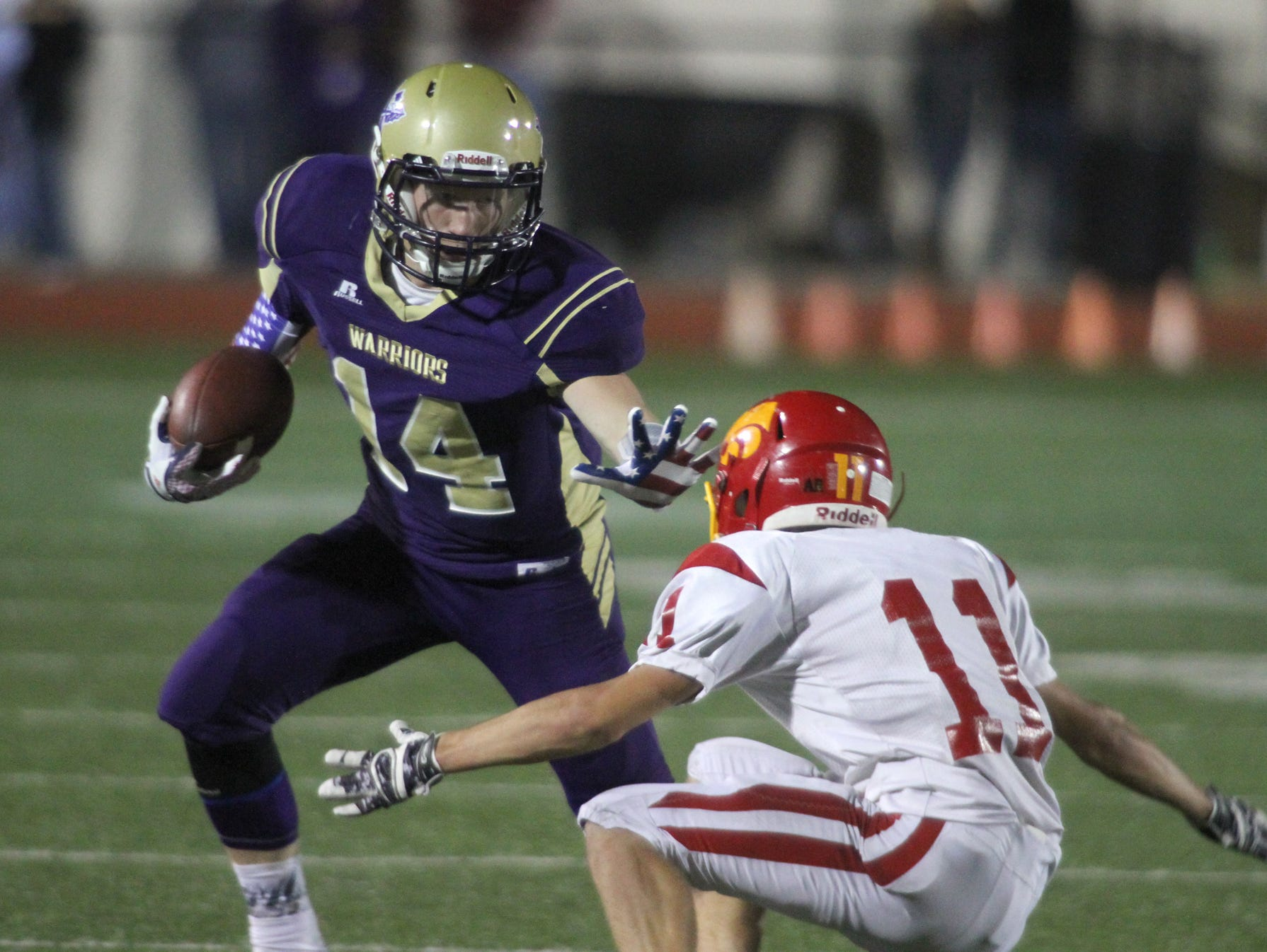 Norwalk senior Tyler Schamel tries to avoid Carlisle junior Dallas Wright. Norwalk hosted Carlisle in their Homecoming game Sept. 11, winning 23-16 with a touchdown in the final minute.