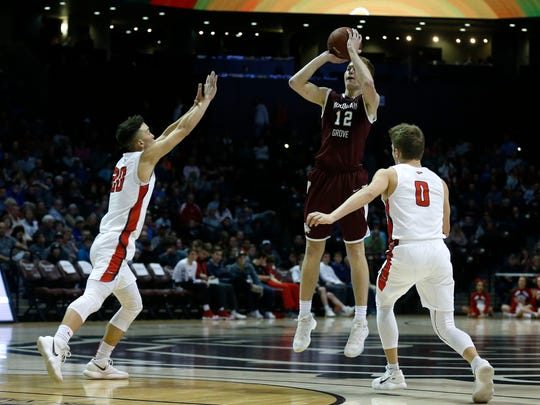 Mountain Grove's Cade Coffman takes a shot over Nixa's Kaleb Wofford during the Blue Division championship game of the 2017 Greenwood Blue and Gold Tournament at JQH Arena on Thursday, Dec. 28, 2017. Mountain Grove beat Nixa 68-65.