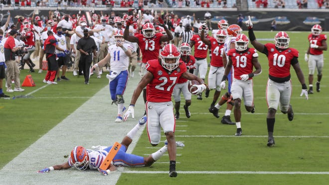 11/7/20 - Jacksonville -   Georgia Bulldogs defensive back Eric Stokes (27) intercepts and returns it for a touchdown for a 21 -14 lead in the second quarter during a NCAA football game between the Georgia Bulldogs and Florida Gators in Jacksonville, FL.
