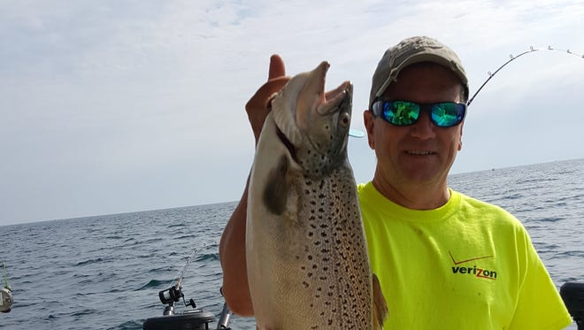 On fishing trip just outside of Oswego, New York, John Korn and friends and family reeled in large brown trout.