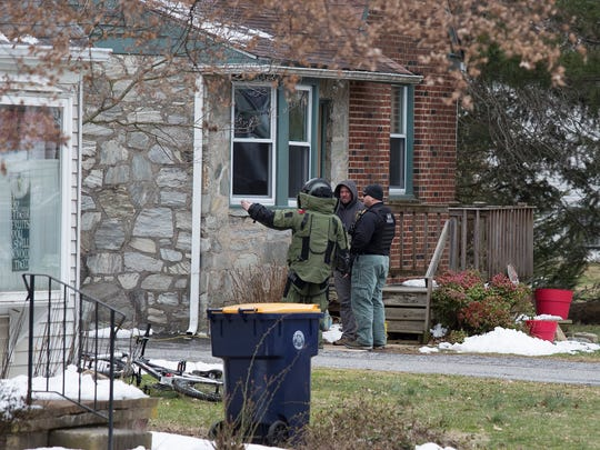 Law enforcement agencies investigate a home that is believed to be related to an explosion that went off shortly after midnight Monday in Elsmere.