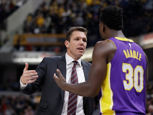 Los Angeles Lakers head coach Luke Walton, left, talks with Julius Randle during the second half of an NBA basketball game against the Indiana Pacers, Monday, March 19, 2018, in Indianapolis. (AP Photo/Darron Cummings)