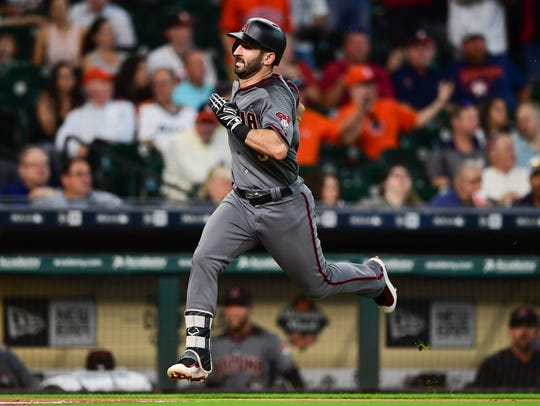 Diamondbacks left fielder Daniel Descalso runs to home
