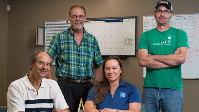 New Mexico State University and IDEALS Inc. formed one of the Mentor/Protégé groups that won the 2017 Nunn-Perry Award, mentored by AGEISS Inc. an international civil engineering company. Pictured from left on July 12, 2018 are Civil Engineering professor Lambis Papelis; Geography Professor Christopher Brown; IDEALS Inc. president Margaret Dubbin; and NMSU alumnus Ryan Blickem.