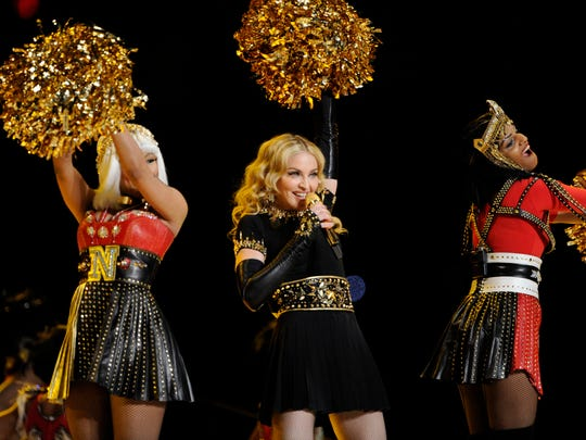 Madonna performs at the Super Bowl  XLVI halftime show.