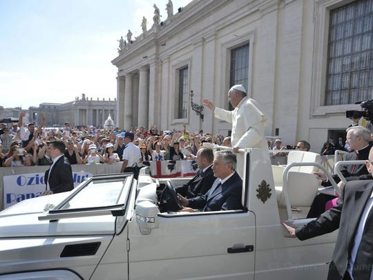 Pope Francis arrives in his Popemobile during his weekly