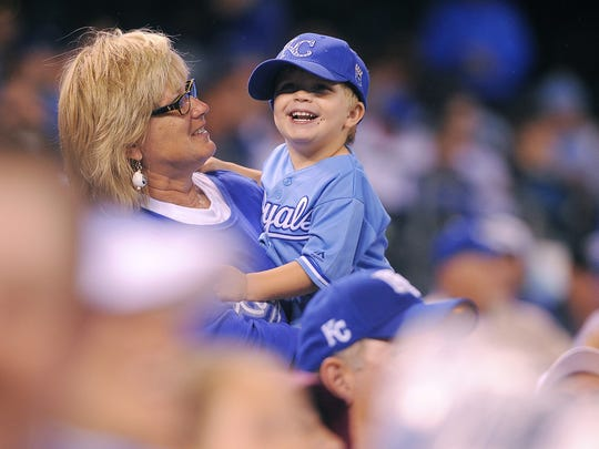 Kansas City fans cheer on their team during a game against Tampa Bay on July 7, 2015, at Kauffman Stadium in Kansas City, Mo.